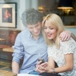 man and woman reading text rewards message