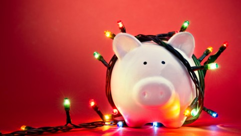 December ideas that drive (piggy bank wrapped in holiday lights)
