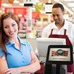 customer at grocery store with CityGro kiosk