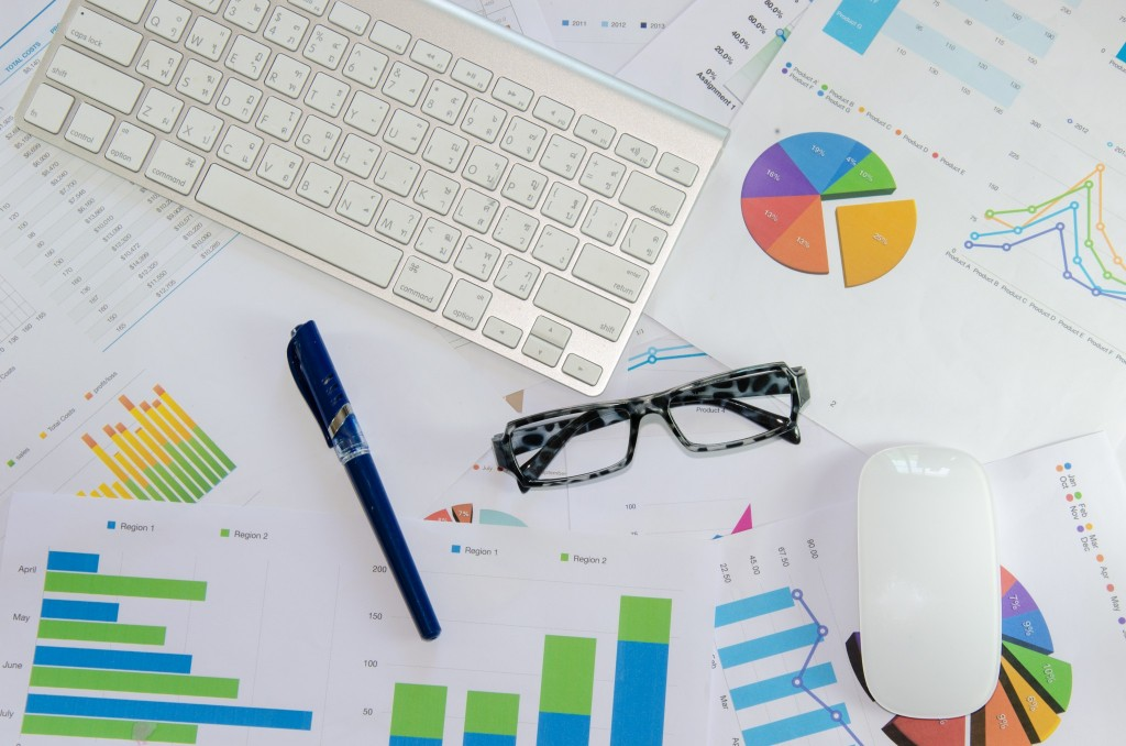 data driven marketing, desk with charts/graphs